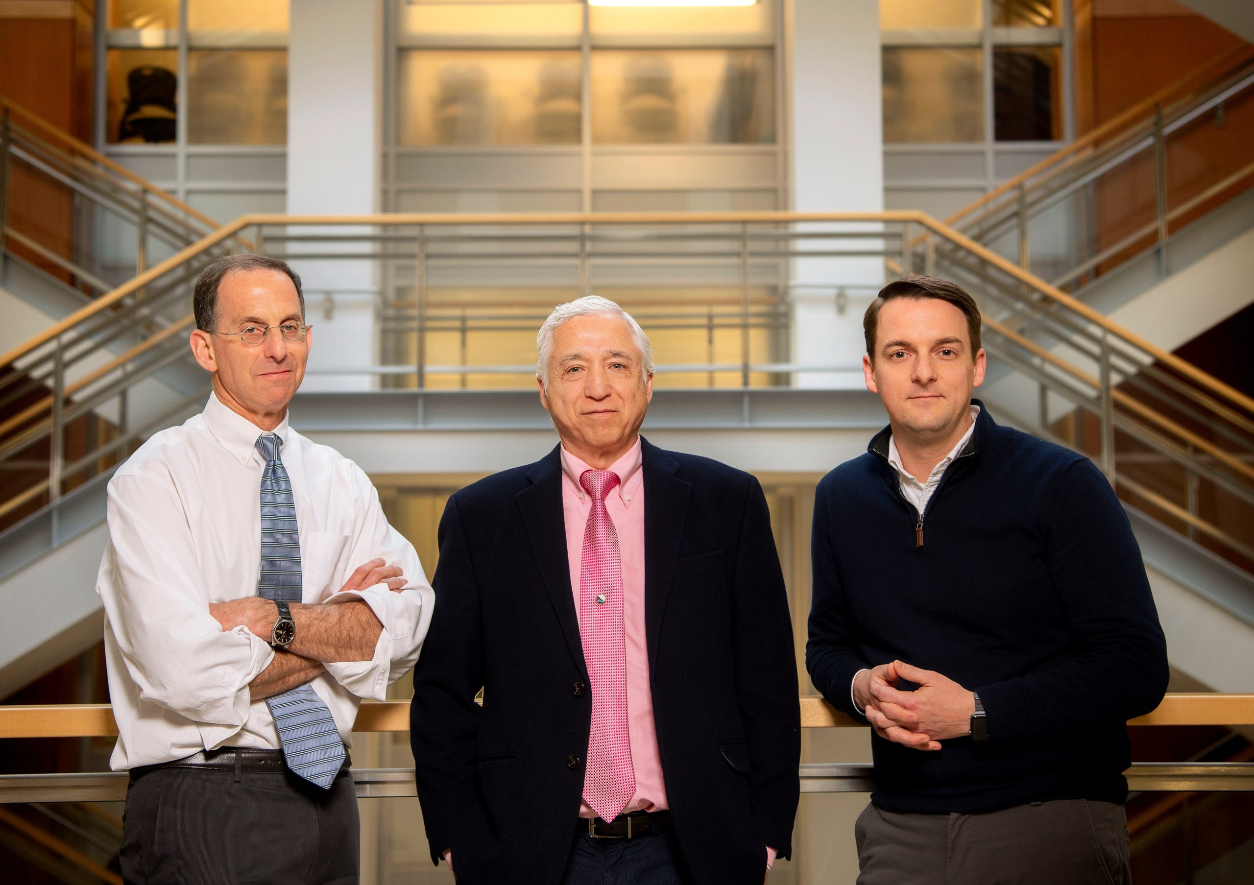 UNC-Chapel Hill HIV researchers David Margolis, MD, and J. Victor Garcia, PhD, along with Rick Dunham from ViiV Healthcare (from left to right), photographed in UNC Genetic Medicine Building